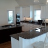 White Thermofoil w/Stained Island - Built for Christi Construction
